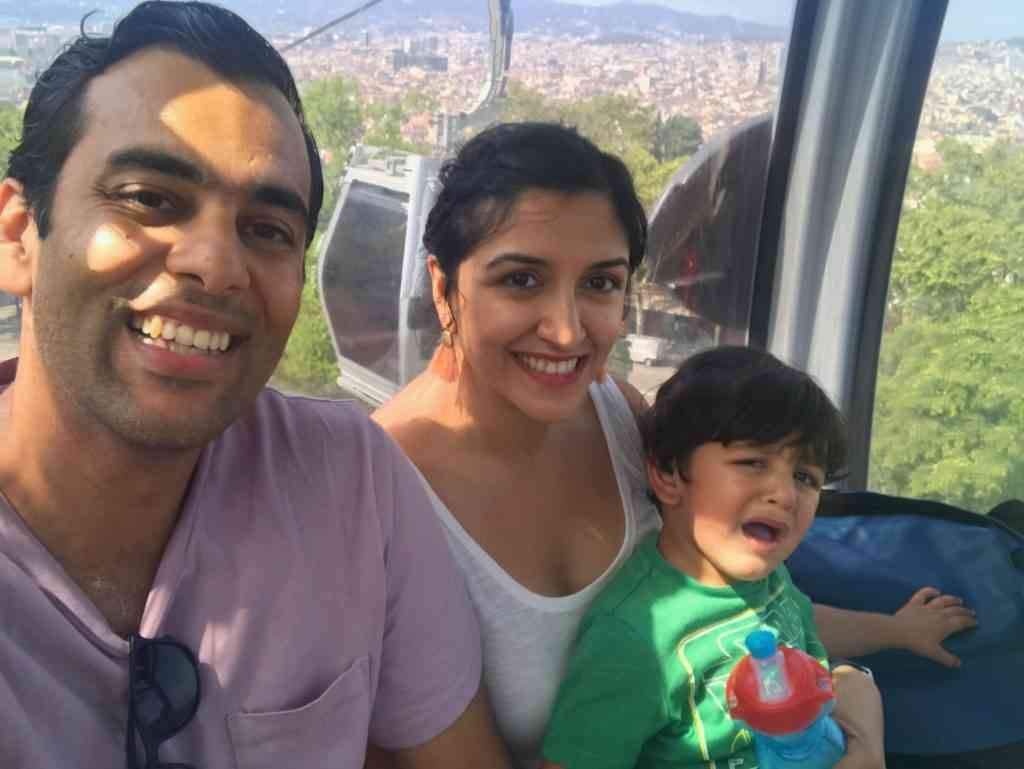 Riding the cable car to the top of Montjuic Park.