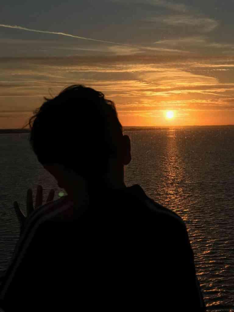 Aarav enjoying an amazing sunset on the cruise ship