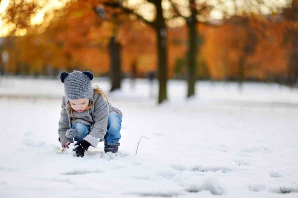 young girl playing in the snow