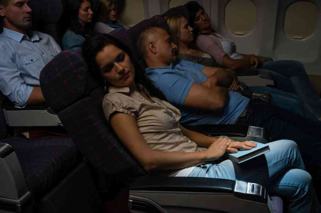 Flight passengers sleeping plane cabin night travel