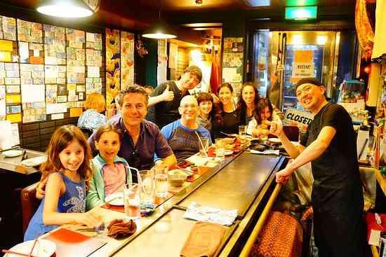 A happy family enjoying a meal at Teppan Tavern Gion.