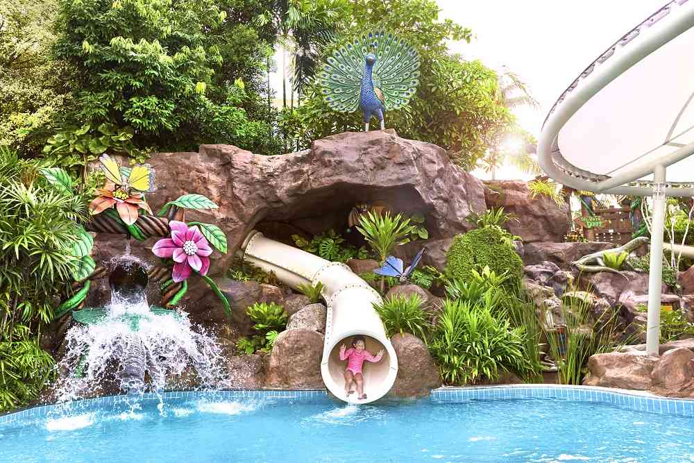 Shangri-La's outdoor pool with slides. A kid's favourite!