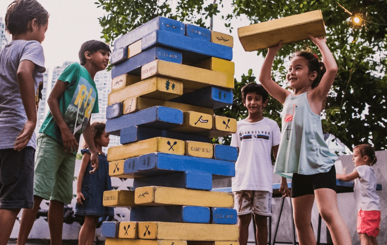 Kids playing at the Camp Kilo Charcoal Club garden
