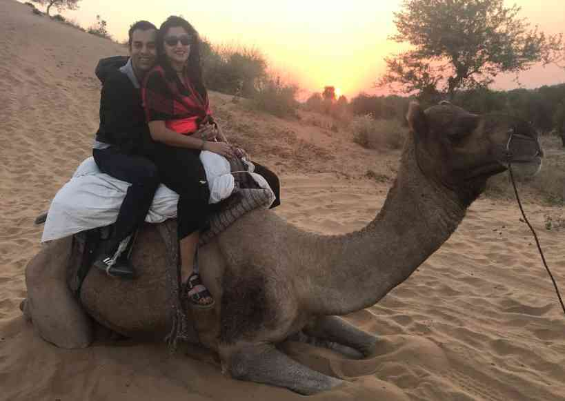 Enjoying a camel ride together in Osian, Rajasthan in India