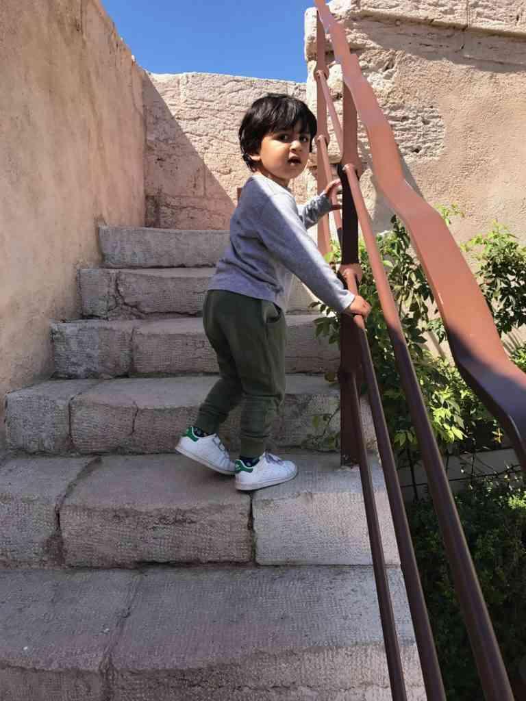 Aarav climbing stairs in Fort Saint-Jean, Marseille
