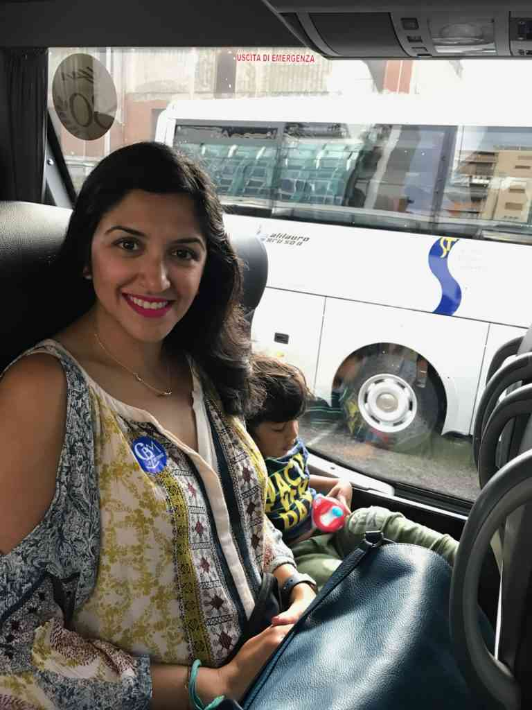 Traveling on a bus with our child in Naples, Italy