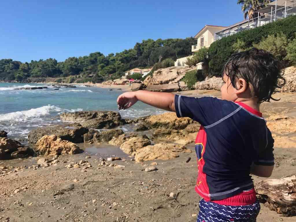 Aarav enjoying the beautiful rocky beaches in Katakolon, Greece