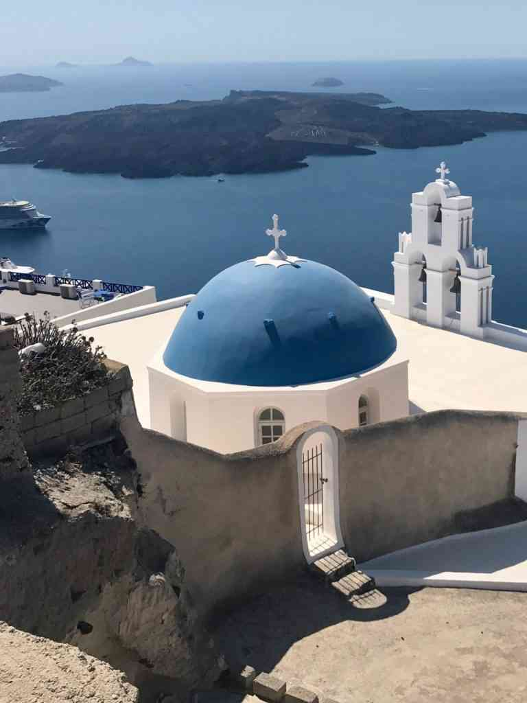 Postcard shot of the incredible blue dome in Firostefani (Three bells of Fira)