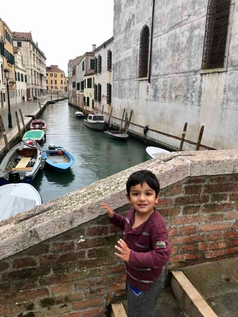 Aarav enjoying going up and down the stairs in Venice