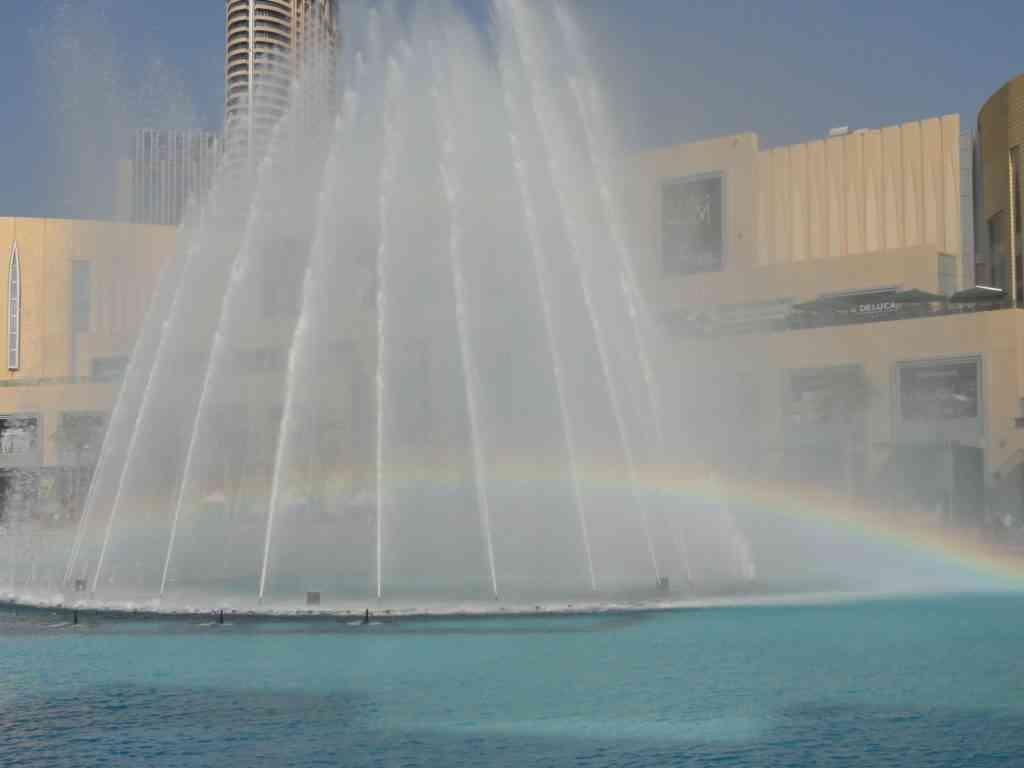 A rainbow going through the Dubai fountain show