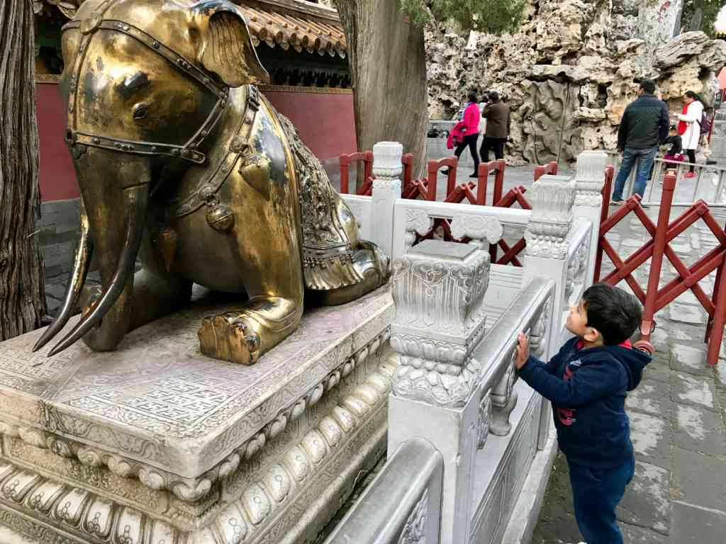 Aarav saying hi to the Elephant statue at The Forbidden City in Beijing