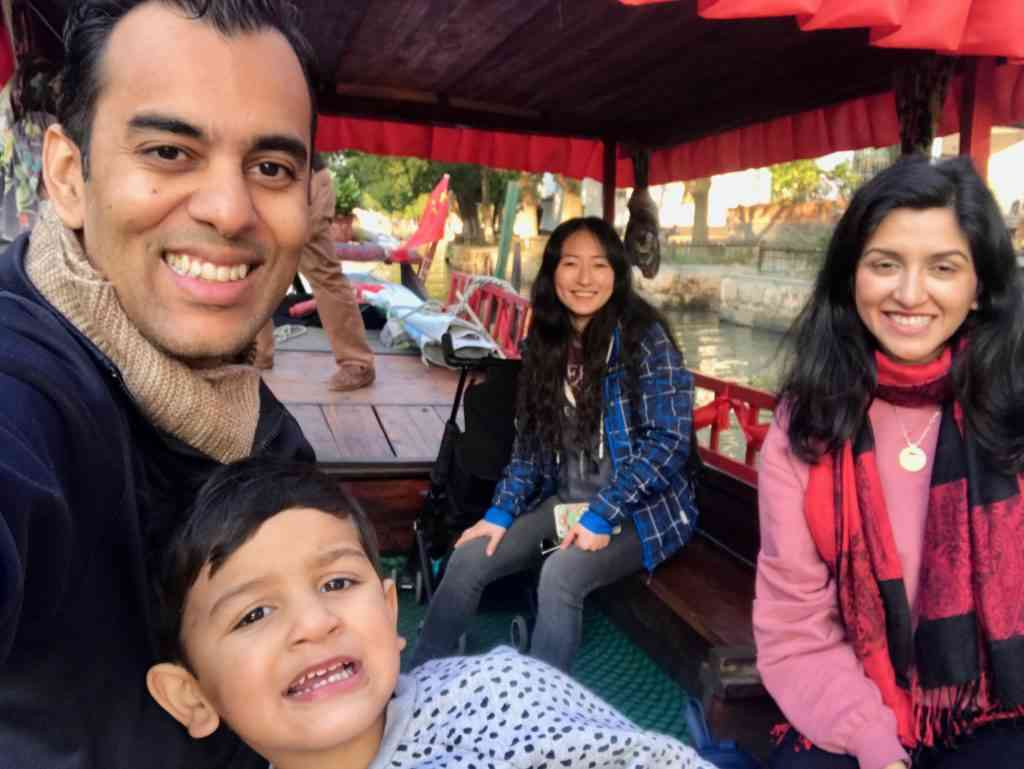 One of our favorite pictures from the boat tour in Jinze Water Town with the family and our tour guide