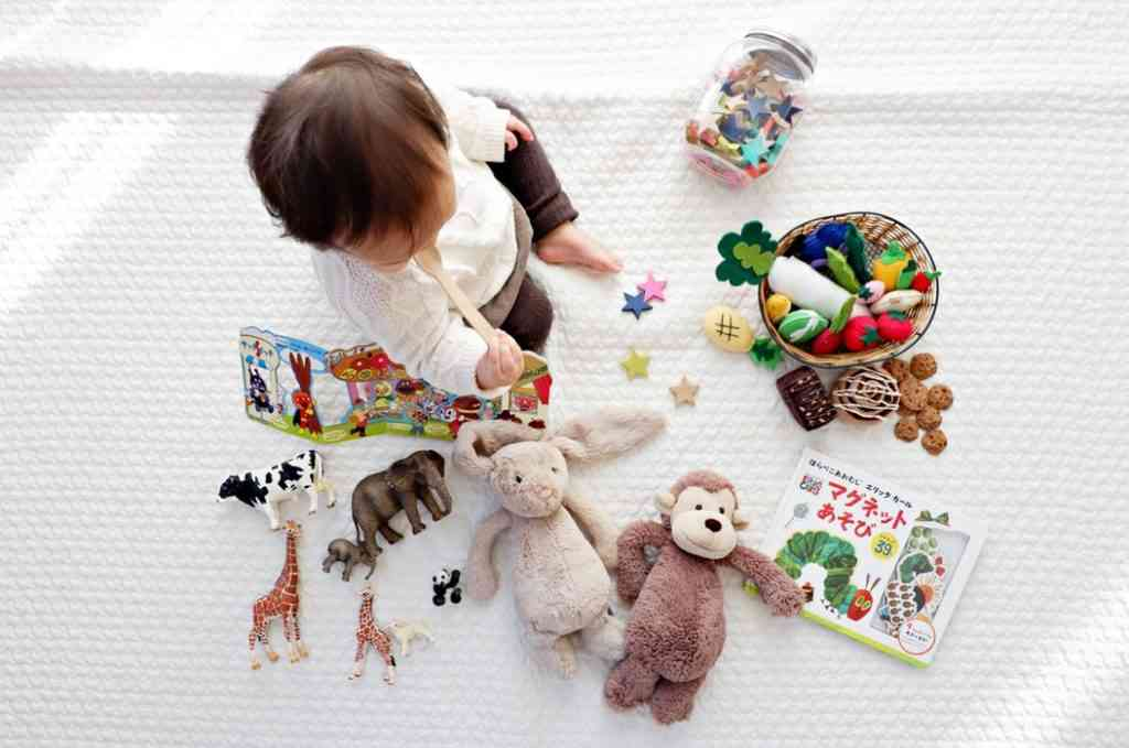 baby surrounded by books and toys