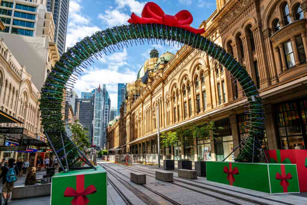 Sydney Christmas decoration on George street framing a view of the Queen Victoria Building or QVB in Sydney NSW Australia